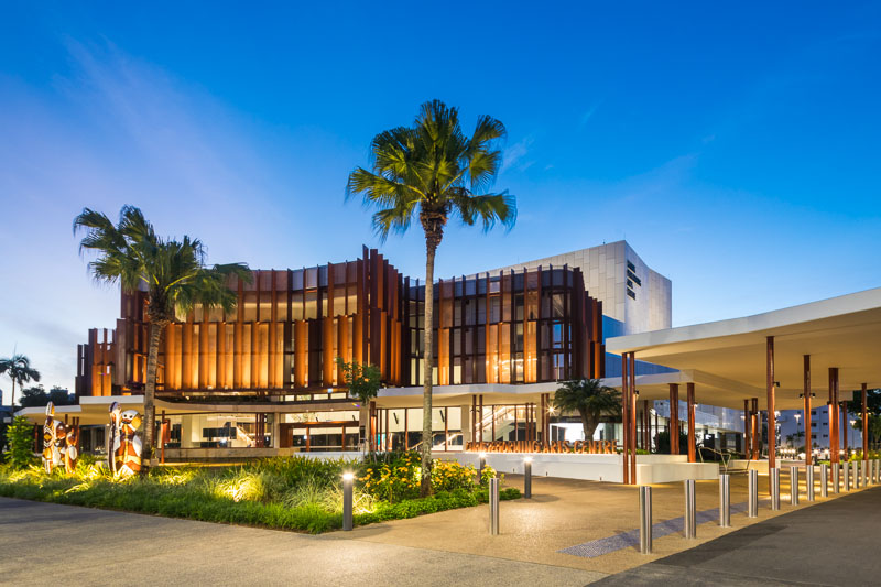 The Cairns Performing Arts Centre illuminated at twilight, Cairns