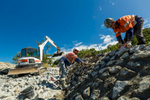 Construction workers building a boat ramp wall, near Mossman