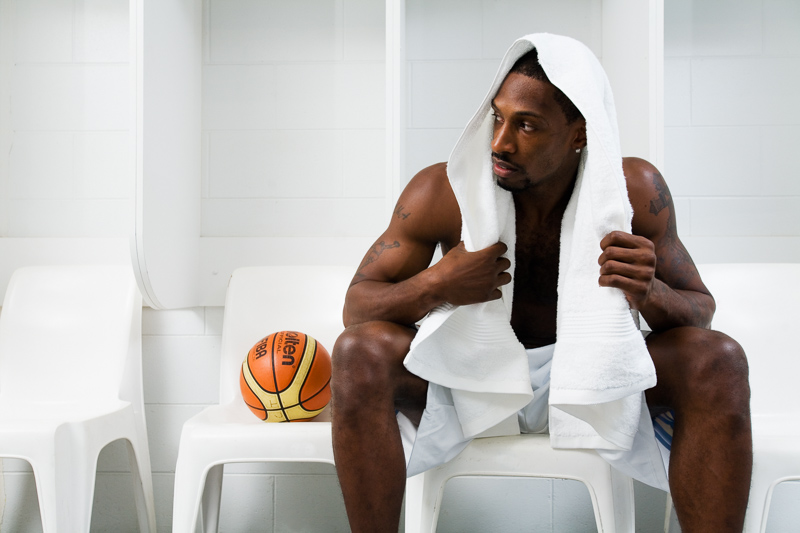 Portrait of professional basketballer, Larry Abney sitting in locker room, Cairns