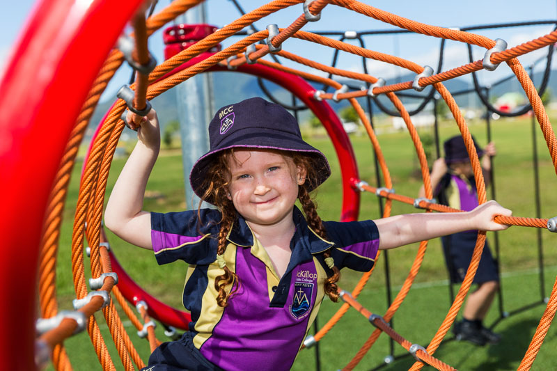 Portrait of a young female schoolchild at play in the playground