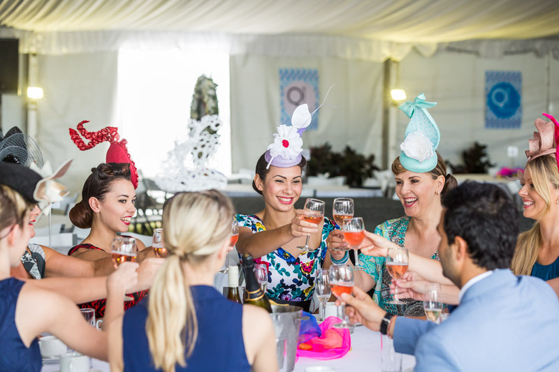 Ladies in racing fashions celebrating at Cairns Amateurs Racing Carnival