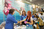 Delegates shaking hands at the 2014 Australian Tourism Exchange in Cairns