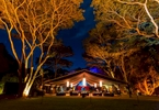 Flames of the Forest dinner venue illuminated at night, Port Douglas