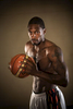 Portrait of professional basketballer, Larry Abney standing with basketball in hand, Cairns