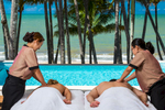 Couple receiving a massage by the pool at Alamanda Resort Palm Cove