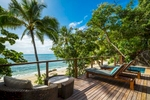 Deck of beach villa overlooking the Coral Sea at Bedarra Island Resort