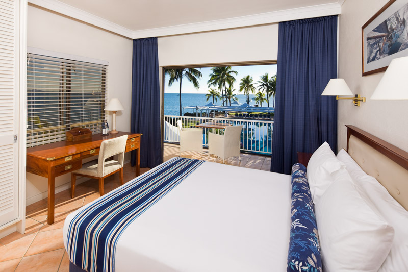 Hotel room with views over pool at the Coral Sea Resort, Airlie Beach