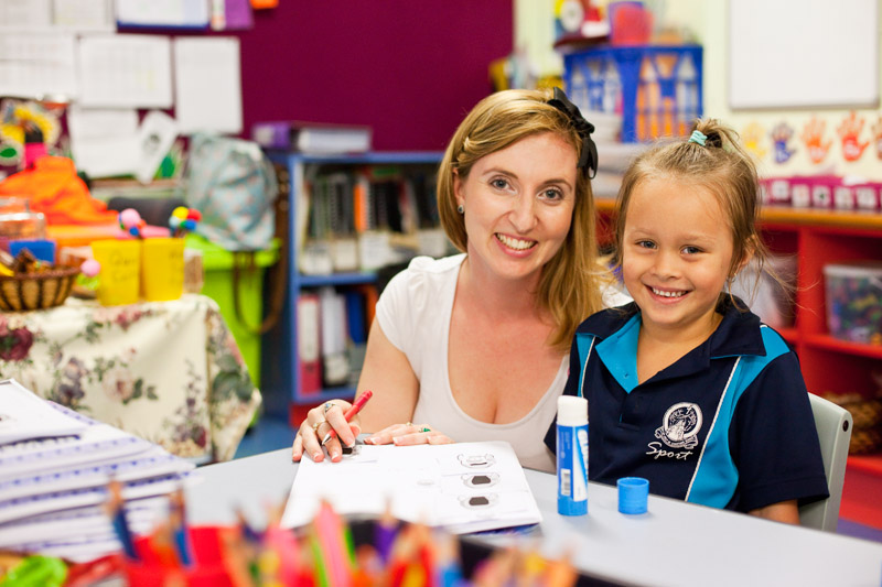 Portrait of a teacher and young student in the classroom, Cairns