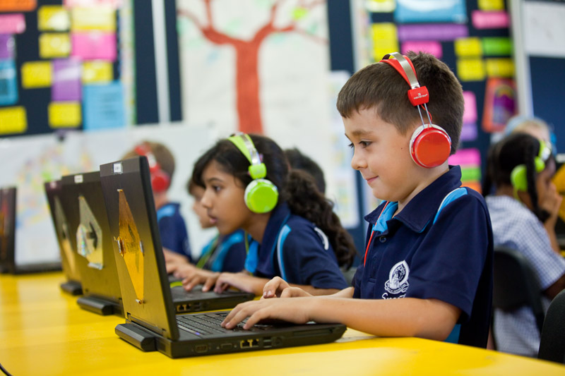 Students learning through technology in the classroom