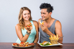 Couple enjoying a pizza and fish and chips at Frydays Fish & Chippery in Cairns