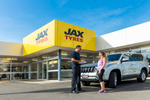 Tyre store manager talking to a customer with their vehicle at JAX Tyres in Cairns