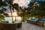 Deck of Beach House overlooking a tropical beach scene at Bedarra Island Resort