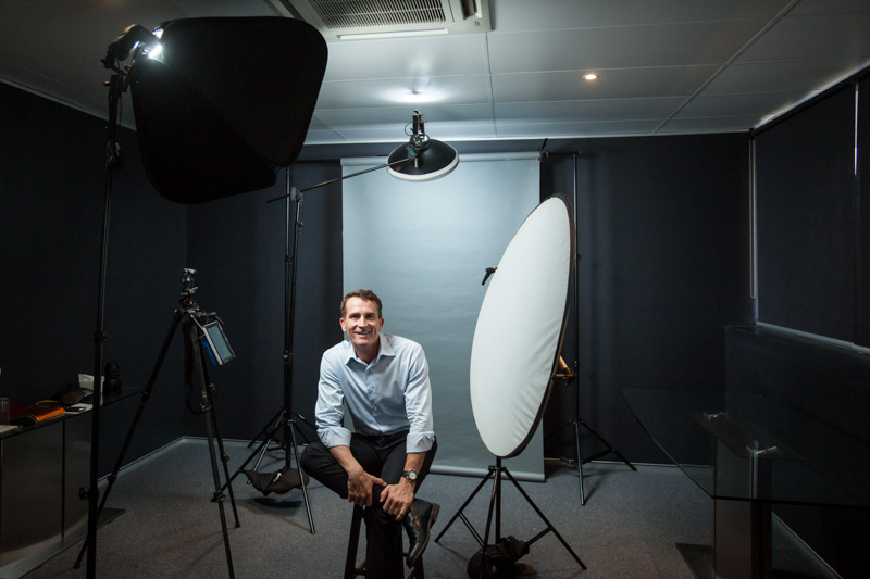 Business executive sitting in a location photo studio setup, Cairns