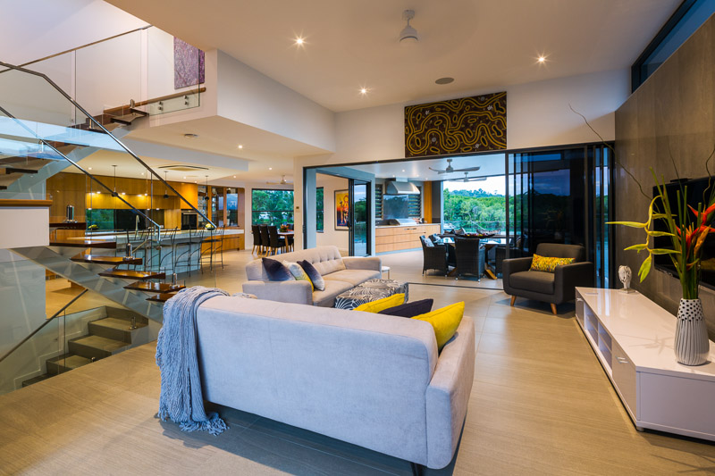 Interior image of living room and outdoor dining area at Marina Quay property, Cairns