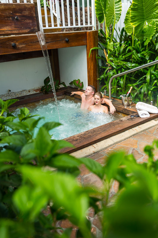 Couple relaxing in outdoor spa at The Reef House, Palm Cove