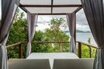 Daybed views overlooking the sea at Bedarra Island Resort