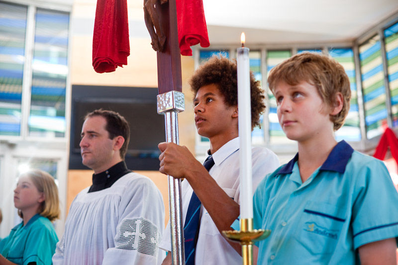 Students participating in a religious mass at a Catholic school