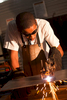 A student wearing protective gear learning oxy acetylene cutting