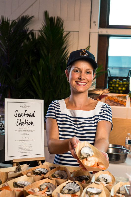 Waitress offering seafood tasting at 2014 Australian Tourism Exchange Farewell Function in Cairns