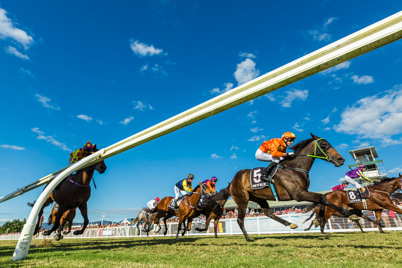 View of horse racing down the finishing straight at Cairns Amateurs Carnival 2015