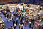 Delegates walking amidst the trade exhibit at the Australian Pipeline Industry Convention, Cairns