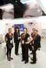 Portrait of booth staff at the Cosmetex 2012 Conference trade exhibition in Cairns