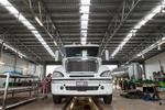 A Freightliner truck inside a mechanical workshop, Mourilyan