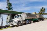 A sugar transportation truck with Sugar Terminal in background, Innisfail