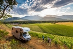 Campervan parking overlooking vineyards with couple getting a personalised tour of winery