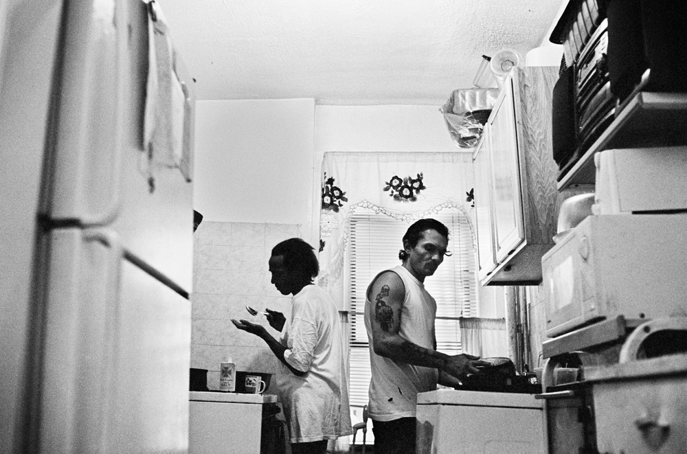 BRONX, NEW YORK - JULY 24: Wilfredo {quote}Sugar{quote} Gonzalez and her husband Luis San Oguel, both HIV-positive, make dinner for the children Sugar cares for in their apartment in the University Heights neighborhood of the Bronx, July 24, 2013.