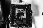 BRONX, NEW YORK - JULY 24: Luis San Oguel shows a photograph of himself and his daughter taken while he was in prison, and which hangs in the apartment he shares with his wife Wilfredo {quote}Sugar{quote} Gonzales in the University Heights neighborhood of the Bronx July 24, 2013.