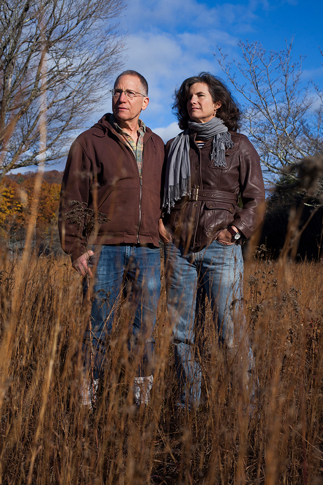 Dr. Richard S. Ostfeld and Dr. Felicia Keesing in a field in front of the Cary Institute of Ecosystem Studies in Millbrook, New York on November 4, 2016. Photo by Stephen Reiss for NPR.