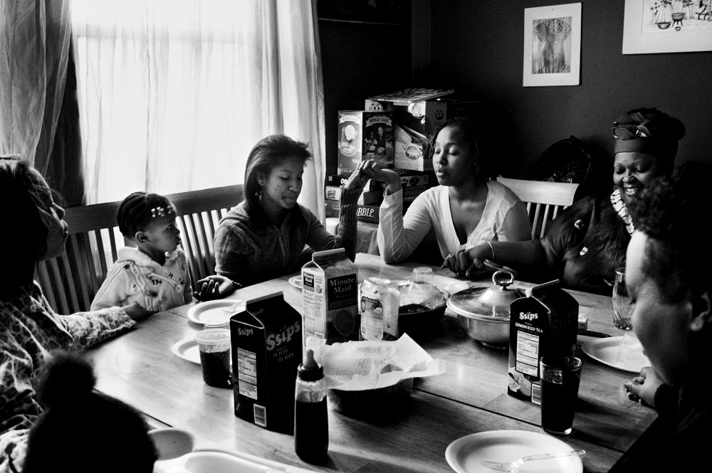 SOUTH BRONX, NEW YORK - MAR 1: Breakfast prayers are spoken at the home Eshey Scarborough and Paris Harris share with their five foster children and Eshey's birth daughter March 1, 2009.