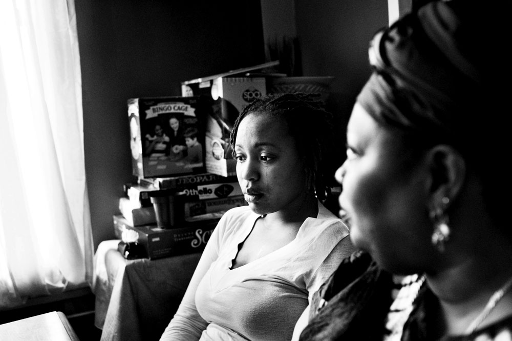 SOUTH BRONX, NEW YORK - MAR 1: Eshey Scarborough's birth daughter, Marshey, cries during breakfast at the foster home run by Eshey and her partner Paris Harris March 1, 2009.
