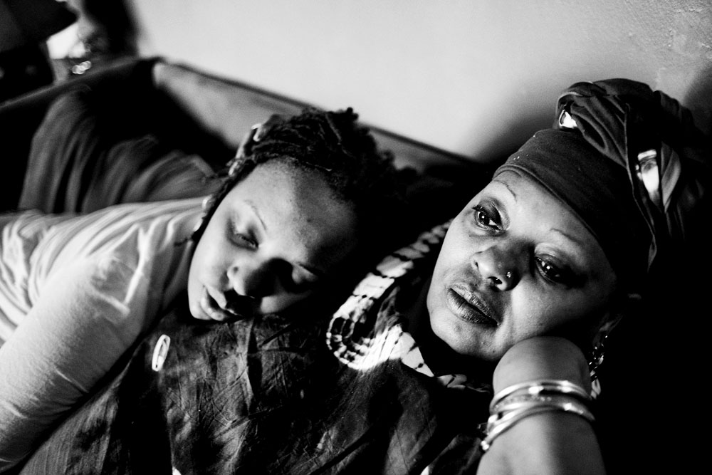SOUTH BRONX, NEW YORK - MAR 1: Eshey Scarborough's birth daughter, Marshey, falls asleep on her mother's chest while watching television March 1, 2009. Marshey shares a home with Eshey and her partner Paris Harris' five foster children.
