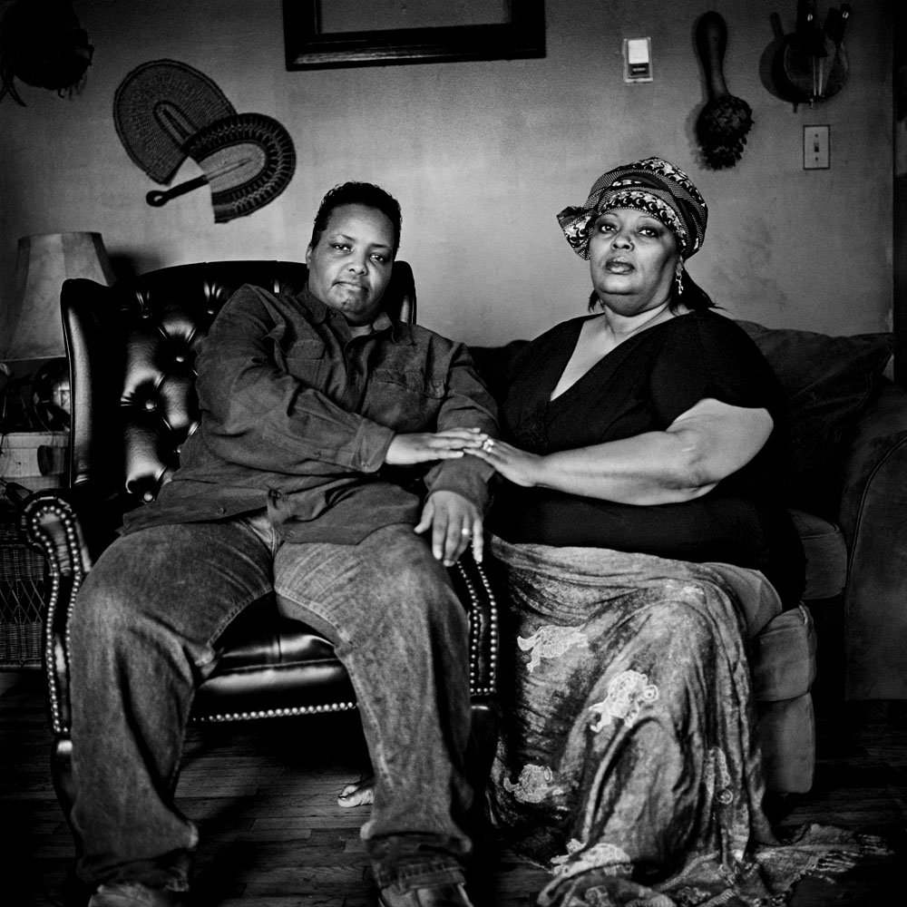 SOUTH BRONX, NEW YORK - APR 2: Paris Harris, left, and her partner Eshey Scarborough in the living room of their foster home for at-risk youth April 2, 2009.