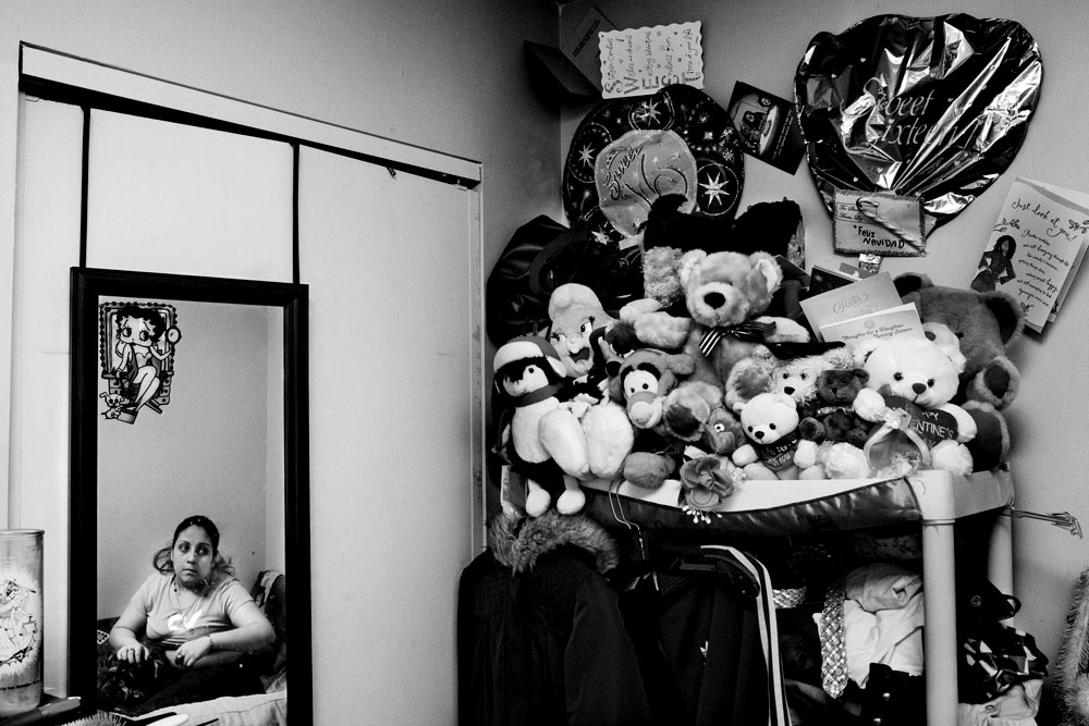 SOUTH BRONX, NEW YORK - APR 16: Foster child Karoline Harris, 17 years old, in her bedroom with her dogs April 16, 2009.