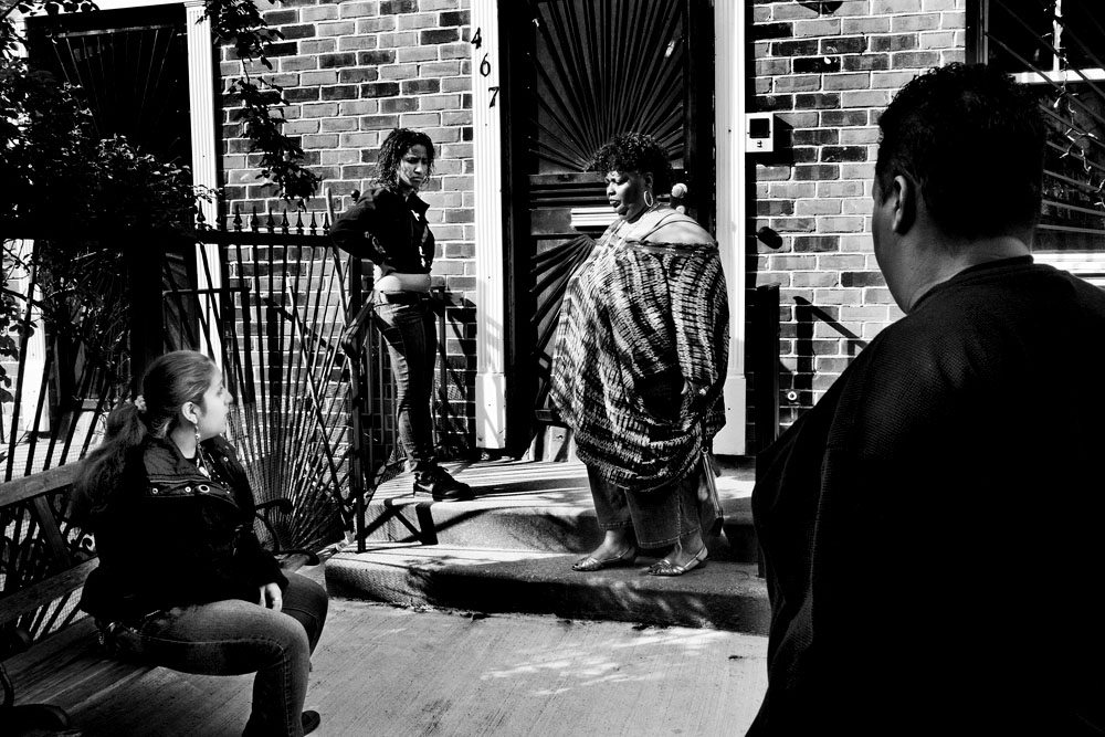 SOUTH BRONX, NEW YORK - MAY 2: Left to right, Karoline Harris, 17, and Daybelis Ramirez, 16, in front of their home with their foster parents Eshey Scarborough and Paris Harris May 2, 2009.