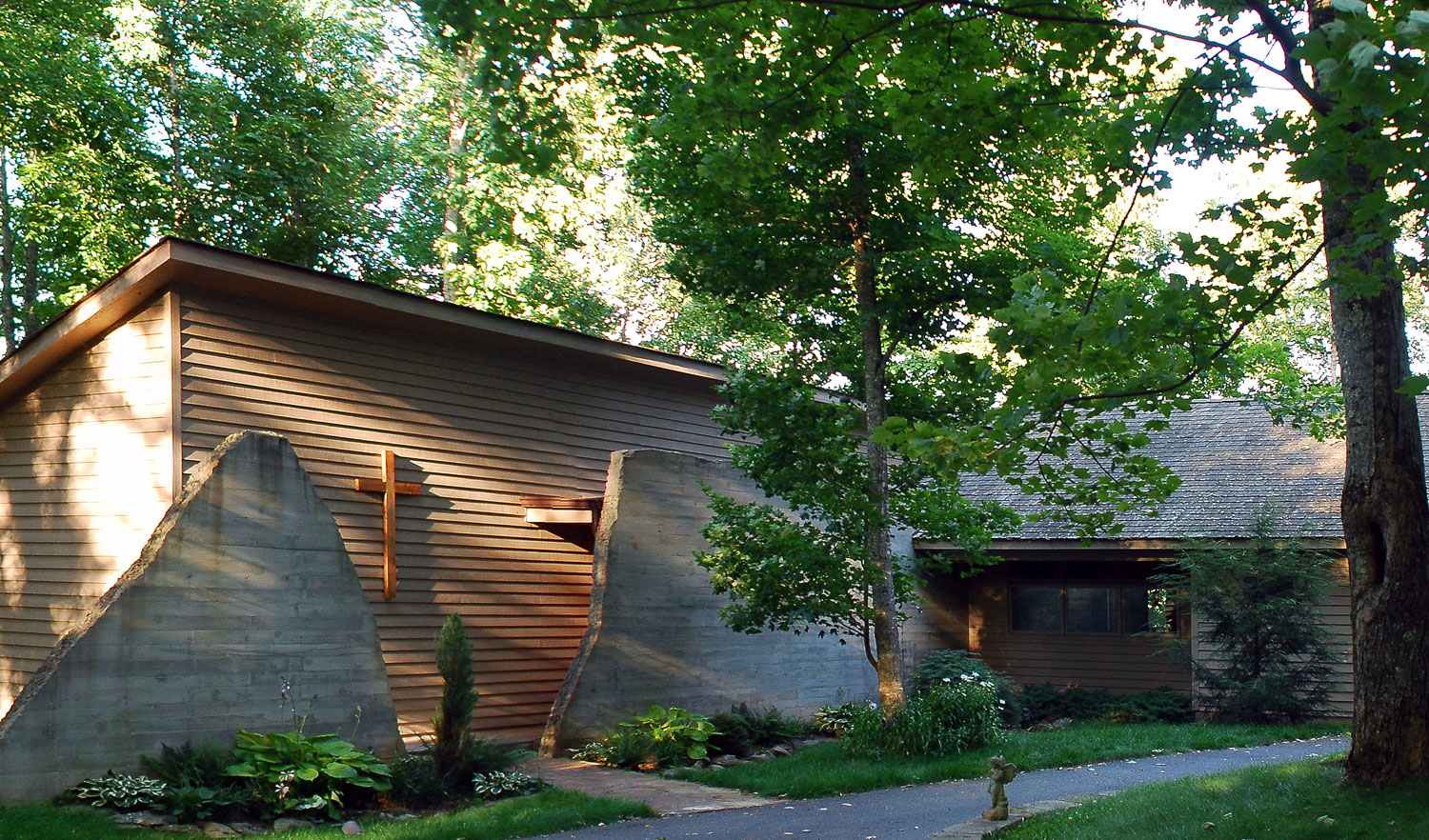 Exterior of custom designed home by Pavelchak Architecture in Valle Crucis, North Carolina, near Boone that showcases exposed cast in place concrete.