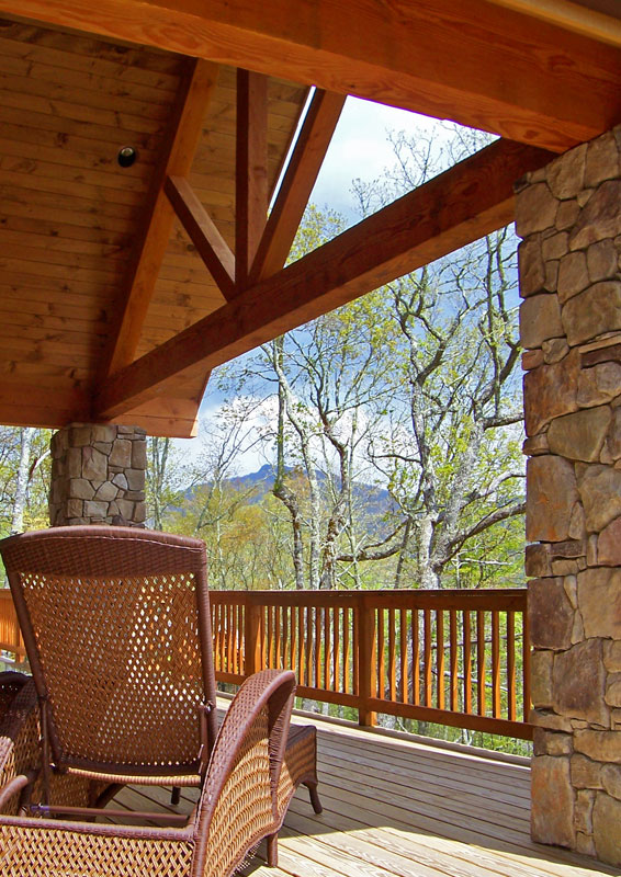 Exterior covered deck of custom designed home by Pavelchak Architecture in The Farm at Banner Elk, North Carolina, near Boone North Carolina.