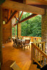 Exterior covered deck of custom designed home by Pavelchak Architecture in Grandfather Golf and Country Club in Linville, North Carolina, near Boone.