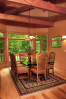 Dining room of custom designed home by Pavelchak Architecture in Grandfather Golf and Country Club in Linville, North Carolina, near Boone.