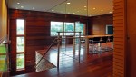 Pavelchak Architecture's conference room showcasing modern, clean design aesthetic with beautiful brazillian cherry and maple hardwoods set against a stunning glass wall.   Located in downtown Banner Elk, North Carolina near Boone. Custom conference table by Miter's Touch.Custom conference table by Miter's Touch.