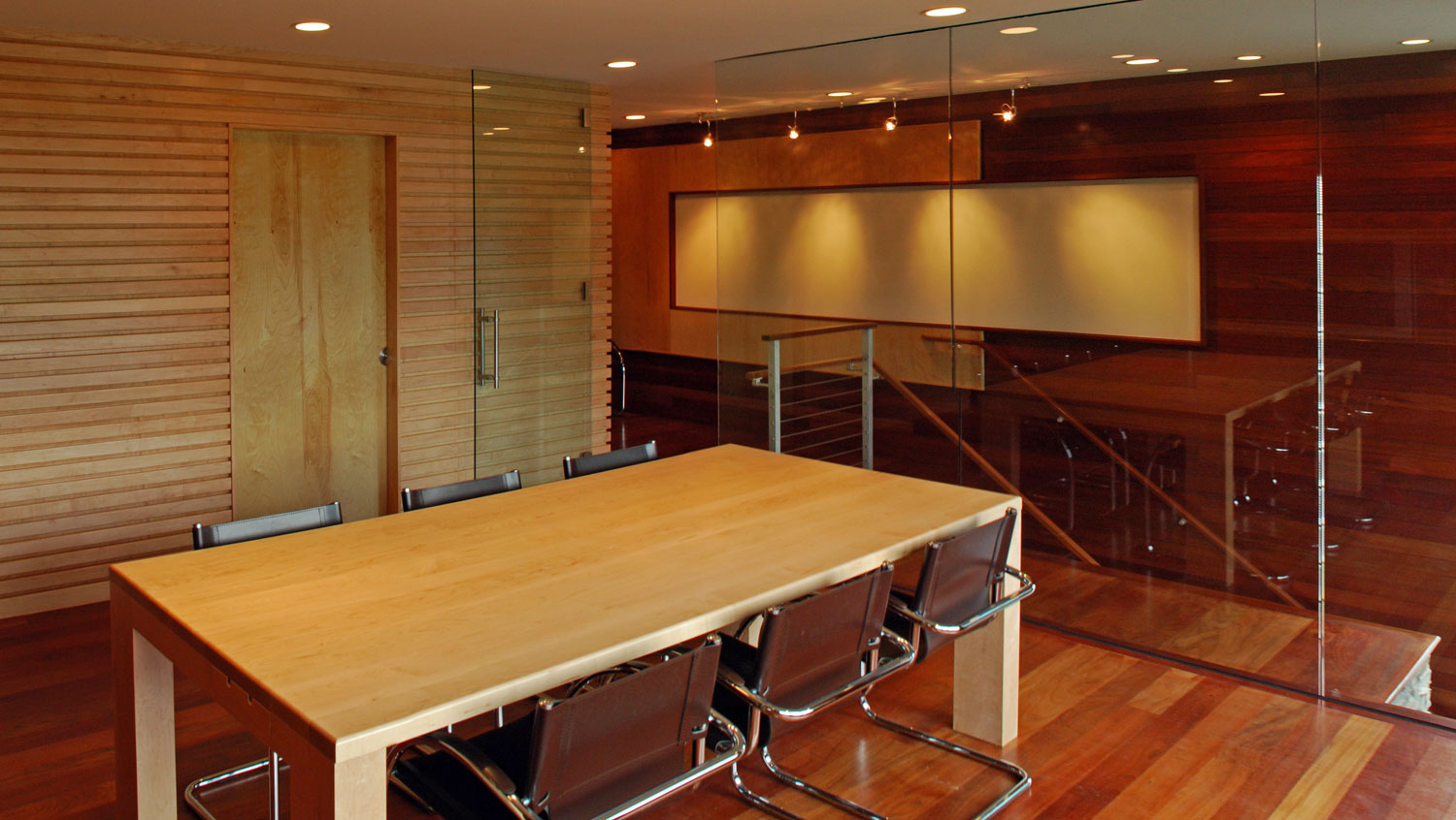 Pavelchak Architecture's conference room showcasing modern, clean design aesthetic with beautiful brazillian cherry and maple hardwoods.   Located in downtown Banner Elk, North Carolina near Boone. Custom conference table by Miter's Touch.