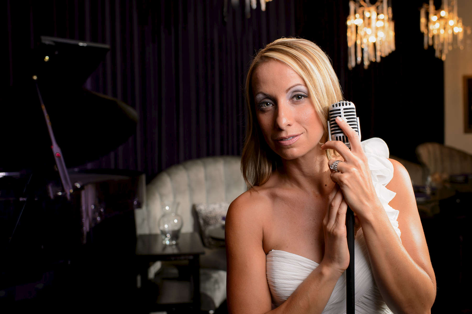 Singer Lorrianna Colozzo holding an old fashioned microphone