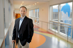 Tom Green, of iMC. is the man in the black jacket in the long hallway of Joe DiMaggio Children's Hospital.
