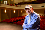 Portrait of John Loesser, Artistic Director of the Lyric Theatre in Stuart FL. John is photographed on the stage of the Theatre with his back to the audience.