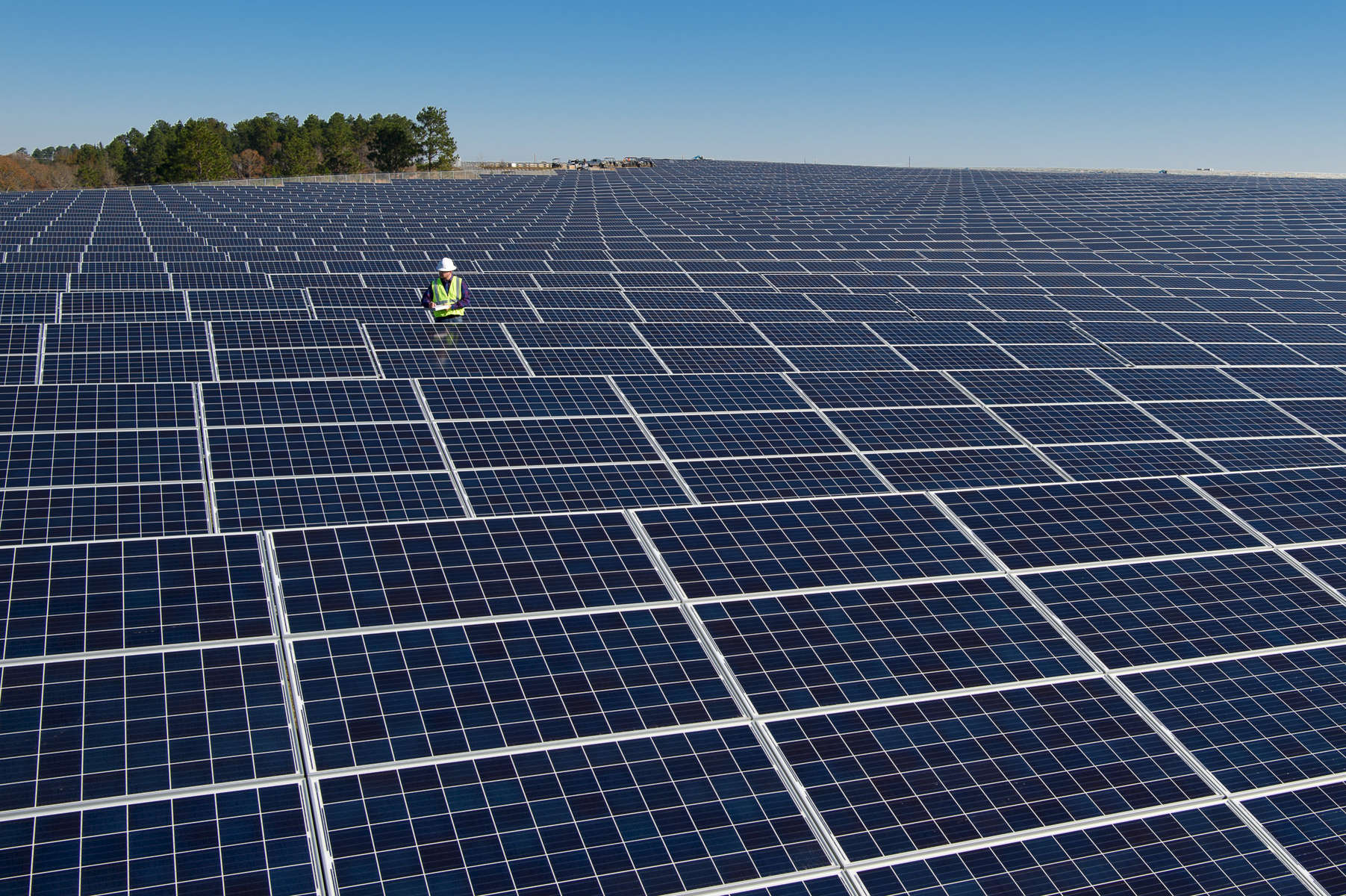 Working inspecting a solar field