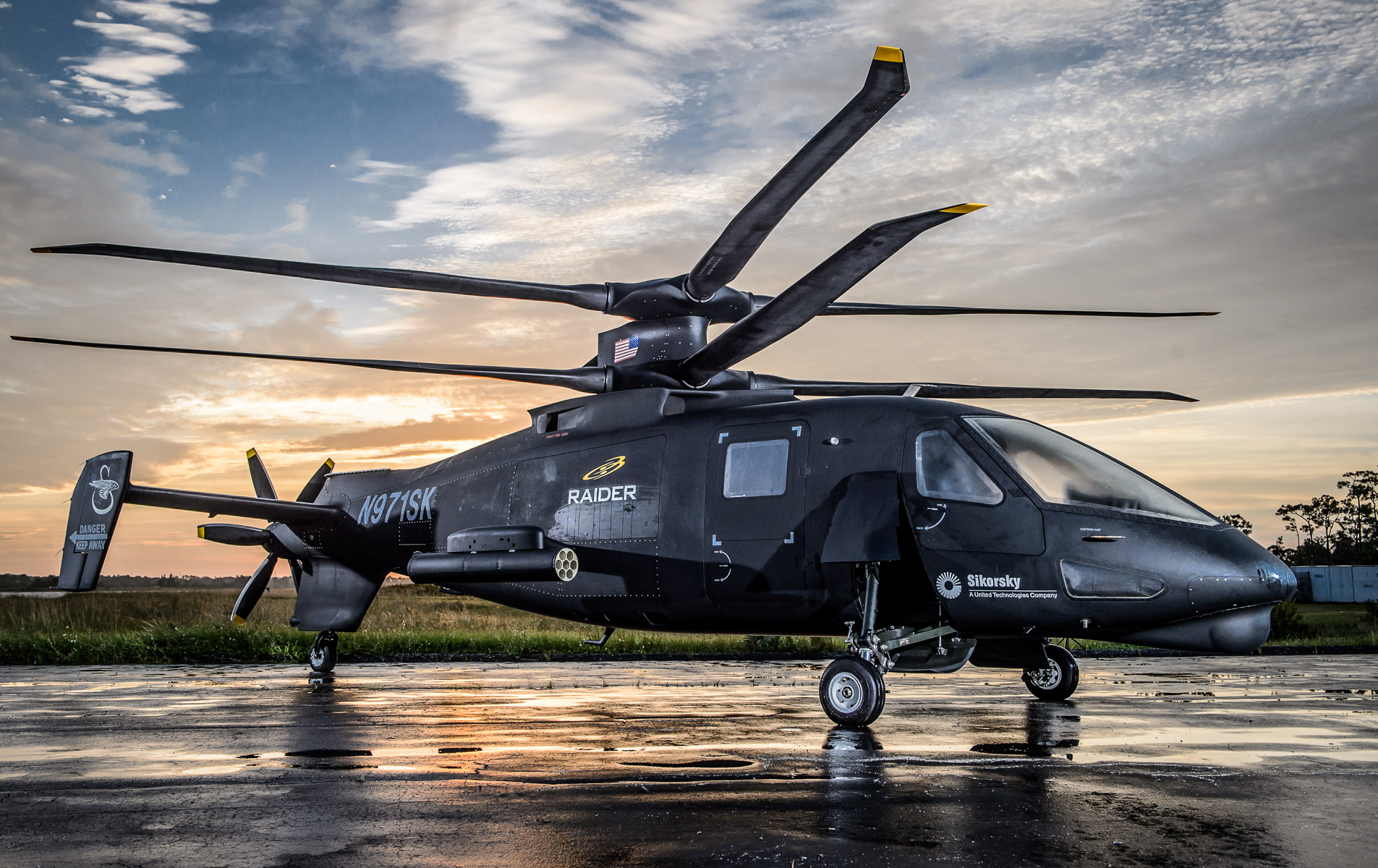 Image of a Military Helicopter Photographed at Sunrise