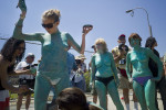 Andy Golub body painting during the Mermaid Parade in Coney Island, Brooklyn.  June 23, 2012